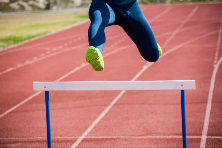 Woman Jumping Over a Hurdle