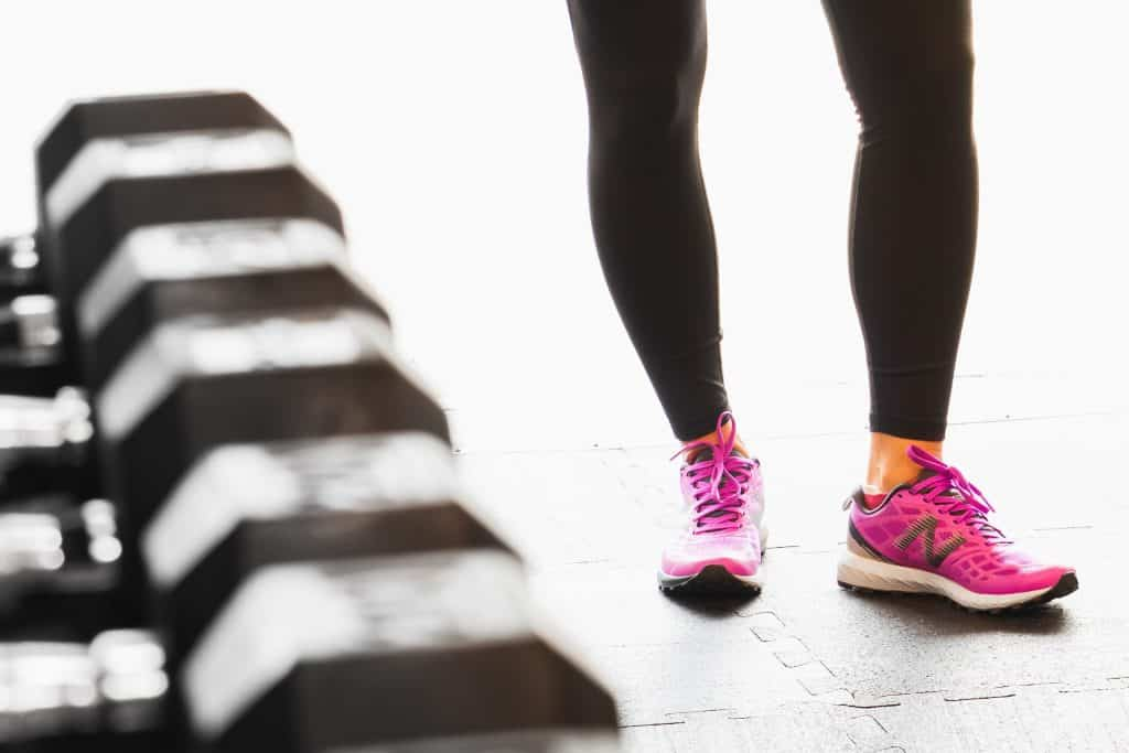 Person Wearing Pink Running Shoes at a Gym