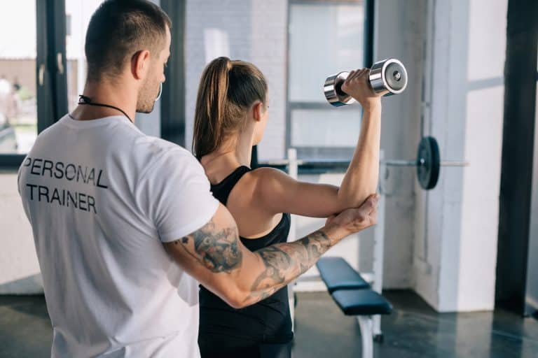 Trainer Assisting with Lifting Form