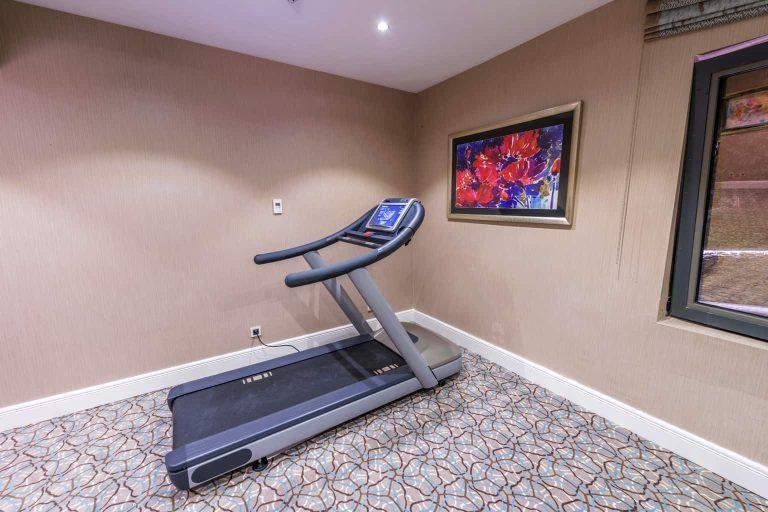 Treadmill at a Corner of a Room