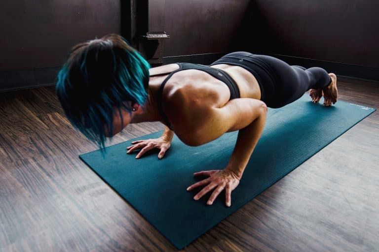 Woman Exercising on a Mat