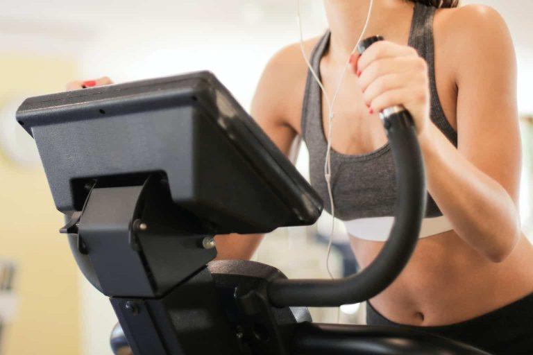 Woman Holding on a Treadmill Handlebars