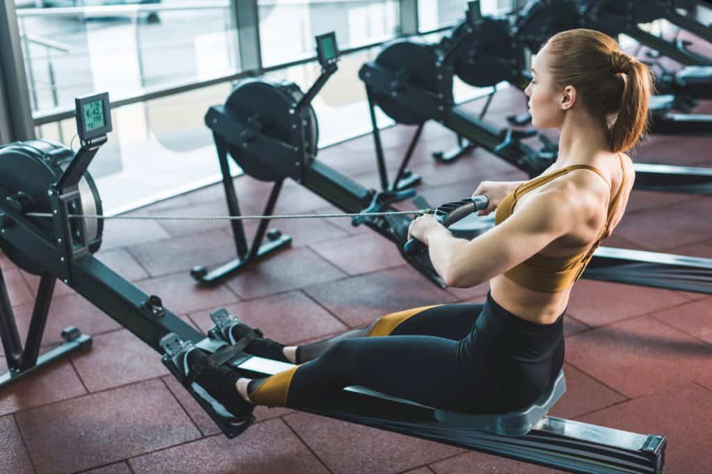 Woman Rowing on a Gym