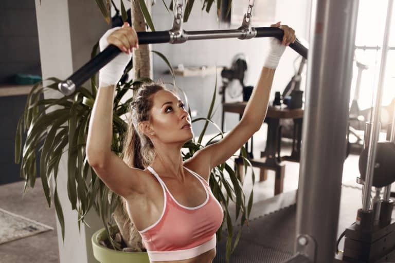 Woman Using Lat Pulldown Machine