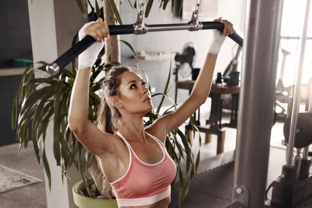 Woman Using Lat Pulldown